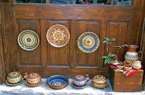 Traditional Bulgarian pottery on display outside gift and craft shop, Tryavna, Bulgaria