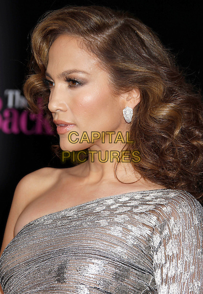 "JENNIFER LOPEZ .""The Back-up Plan"" Los Angeles Premiere held at the Regency Village Theatre, Westwood, California, USA, 21st April 2010. .arrivals portrait headshot silver one shoulder sleeve profile side shiny shimmery sheer earring wavy hair .CAP/ADM/MJ.©Michael Jade/AdMedia/Capital Pictures."