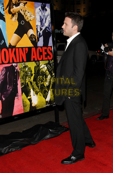 BEN AFFLECK.The Universal Pictures' World Premiere of Smokin' Aces held at The Grauman's Chinese Theatre in Hollywood, California on.January 18th, 2007.full length black suit profile hands in pockets .CAP/DVS.©Debbie VanStory/Capital Pictures