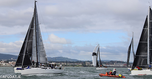 Juggerknot II wins the inside berth and is quick to hoist. John O'Gorman's Hot Cookie is at the Committee Boat RIB