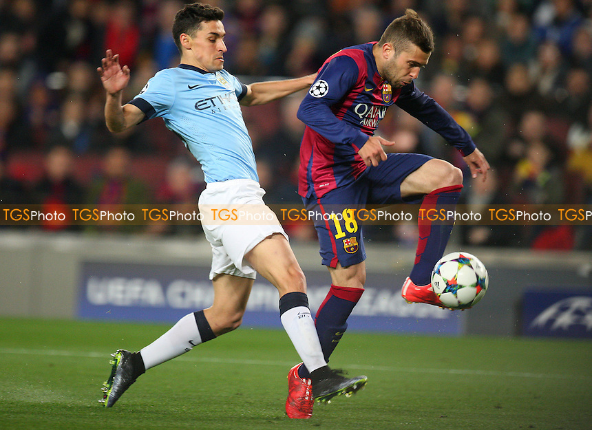 Jordi Alba of FC Barcelona and Jesus Navas of Manchester City - FC Barcelona vs Manchester City - European Champions League Round of Sixteen Football at the Camp Nou Stadium on  18/03/15 - MANDATORY CREDIT: Dave Simpson/TGSPHOTO - Self billing applies where appropriate - 0845 094 6026 - contact@tgsphoto.co.uk - NO UNPAID USE