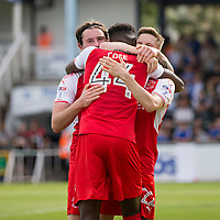 Devante Cole of Fleetwood Town celebrates scoring his side's first goal with Aiden O'Neill and Ashley Hunter during the Sky Bet League 1 match between Bristol Rovers and Fleetwood Town at the Memorial Stadium, Bristol, England on 26 August 2017. Photo by Mark  Hawkins.
