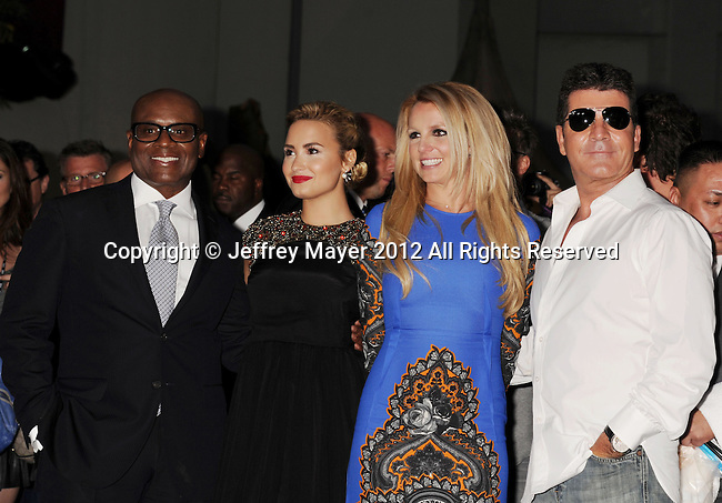 HOLLYWOOD, CA - SEPTEMBER 11: L.A. Reid, Demi Lovato, Britney Spears and Simon Cowell arrive at the 'The X Factor' Season 2 Premiere Party at Grauman's Chinese Theatre on September 11, 2012 in Hollywood, California.