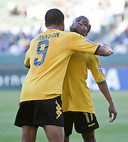 CARSON, CA – June 6, 2011: Jamaican Ryan Johnson (9) congratulates teammate Dane Richards (11) on his goal during the match between Grenada and Jamaica at the Home Depot Center in Carson, California. Final score Jamaica 4 and Grenada 0.
