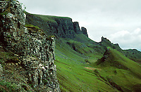 Rock climbing area in the Inner Hebrides of Western Scotland. View of craggy rock formations and rugged green hills of Scottish landscape. Scotland Great Britain Isle of Skye.
