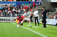Matty Cash of Nottingham Forest battles with Declan John of Swansea City during the Sky Bet Championship match between Swansea City and Nottingham Forest at the Liberty Stadium, in Swansea, Wales, UK. Saturday 15 September 2018
