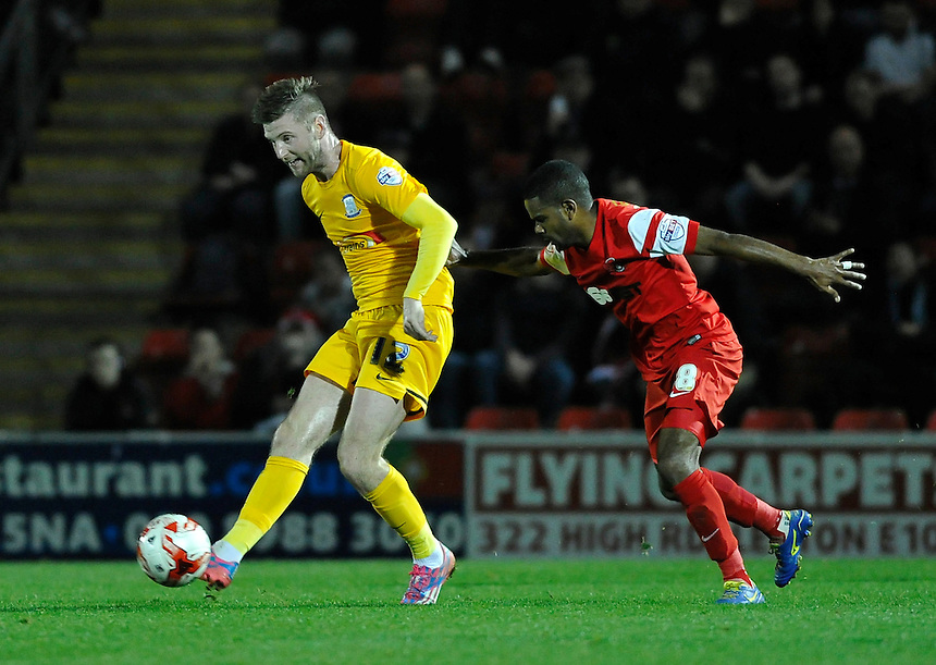 Preston North End's Paul Gallagher shields the ball from Leyton Orient's Bradley Pritchard<br /> <br /> Photographer Ashley Western/CameraSport<br /> <br /> Football - The Football League Sky Bet League One - Leyton Orient v Preston North End - Tuesday 28th October 2014 - Matchroom Stadium - London<br /> <br /> &copy; CameraSport - 43 Linden Ave. Countesthorpe. Leicester. England. LE8 5PG - Tel: +44 (0) 116 277 4147 - admin@camerasport.com - www.camerasport.com