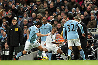 Barclays Premier League, Man City (blue) V Swansea City (white) Etihad Stadium, 27/10812<br /> Pictured: Wayne Routledge is given little space by the City defense<br /> Picture by: Ben Wyeth / Athena Picture Agency