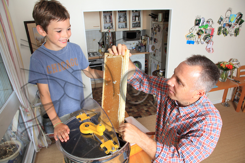 Mister Nicolas Geant and his son extraction honey in a apartment
