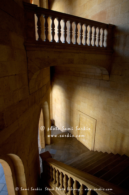 Stone stairwell inside the historic Palace of Charles V at Alhambra, a palace in Granada, Andalusia, Spain.