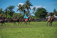 March 28, 2016 - Waiha (Indonesia). A rider throwns a spear towards an opponent. Riders are grouped into 2 teams, based on their traditional clans. The aim of the Pasola is to throw blunted wooden spears at the opposition riders while trying to avoid their counter attacks. © Thomas Cristofoletti / Ruom