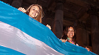 Women hold a Argentina flag while they protest against the policies government of Argentina's President Cristina Fernandez in Buenos Aires April 18, 2013. Photo by Juan Gabriel Lopera / VIEWpress.