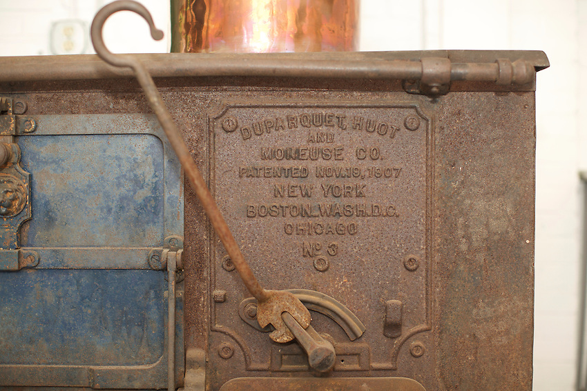 East Greenwich, RI - March 9, 2016: In the studio of East Coast Tinning, where owner, Jim Hamann restores antique copper pots and creates new ones. <br /> <br /> CREDIT: Clay Williams for Edible Manhattan.<br /> <br /> &copy; Clay Williams / claywilliamsphoto.com