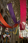 Pictured: The Very Rev'd Catherine Ogle, Dean of Winchester Cathedral admires the vibrant colours of the art installation 'Held in a Burst of Colour' by Rev'd Gill Sakakini as it drapes across the empty nave at Winchester Cathedral, Hants.The bright, bold colours of the fabric pay tribute to the rainbows that people across the country have been placing in their windows during the coronavirus pandemic as a symbol of hope, and welcomes visitors as they enter the Cathedral as it reopened for public service last weekend. <br /> © Jordan Pettitt/Solent News & Photo Agency<br /> UK +44 (0) 2380 458800