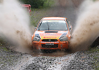 Jock Armstrong / Kirsty Riddick at the watersplash on Special Stage 5 Heathhall of the 2012 RSAC Scottish Rally supported by Dumfries and Galloway Council, Round 5 of the RAC MSA Scottish Rally Championship which was based in Dumfries on 30.6.12.