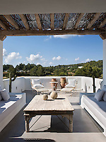 The private terrace that leads off the bedroom is simply furnished with built-in sofas, wrought iron sun loungers and a large wooden Balinese style coffee table. It has panoramic views of the Ibizan countryside