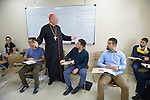 Cardinal Timothy Dolan, archbishop of New York and chair of the Catholic Near East Welfare Association, talks with students in a class in the Catholic University in Ankawa, near Erbil, Iraq, on April 11, 2016.