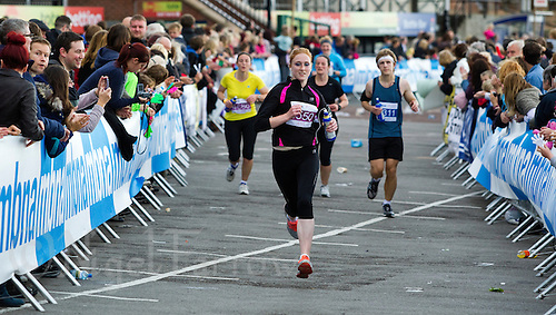 09 SEP 2011 - CHESTER, GBR - Jess Lowry runs the last few metres to the finish line during the MBNA Chester Marathon .(PHOTO (C) NIGEL FARROW)
