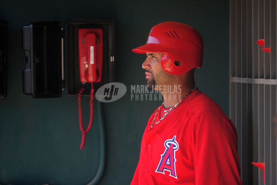 Mar. 14, 2012; Phoenix, AZ, USA; Anaheim Angels first baseman Albert Pujols in the dugout during the third inning against the Chicago White Sox at The Ballpark at Camelback Ranch. Mandatory Credit: Mark J. Rebilas-