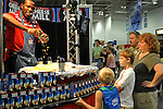 A family watches a vendor's presentation at the vendor's expo at the Wisconsin State Fair in West Allis, Wisconsin on August 3, 2008.