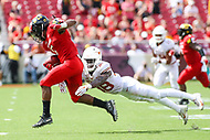 Landover, MD - September 1, 2018: Maryland Terrapins running back Anthony McFarland (5) gets tackled by Texas Longhorns defensive back Kobe Boyce (38) during the game between Texas and Maryland at  FedEx Field in Landover, MD.  (Photo by Elliott Brown/Media Images International)