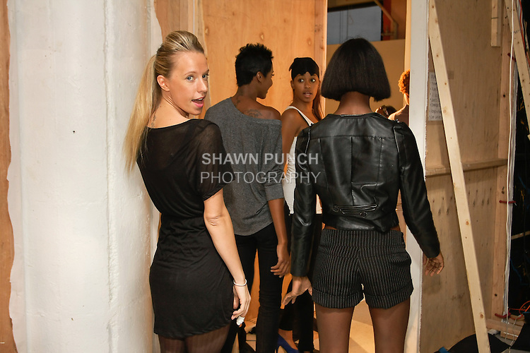 Models line up backstage about to a practice walk through on the runway, during BK Fashion Weekend Spring Summer 2012.