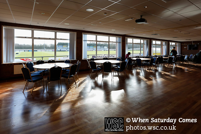 A Southport player waits for his team mates to arrive in the club bar. Darlington 1883 v Southport, National League North, 16th February 2019. The reborn Darlington 1883 share a ground with the town's Rugby Union club. <br />