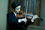 Jasper, violin prodigy, waiting for his next performance in Carnegie Hall