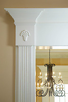Traditional style doorway molding detail and light fixtrue.