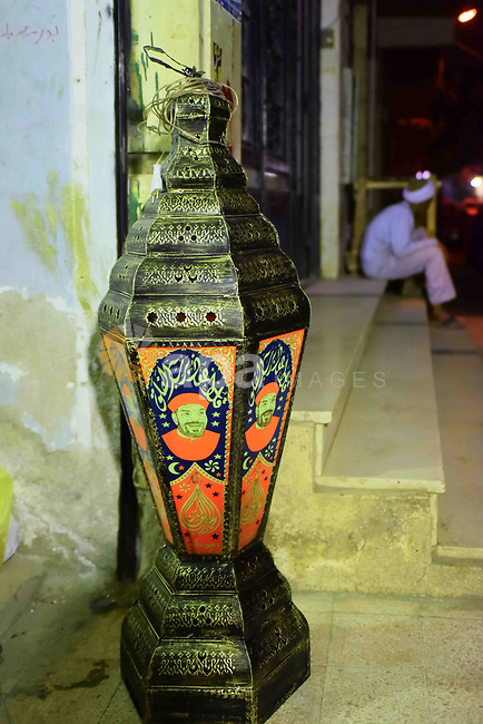 """An Egyptian worker manufactures a traditional Ramadan lantern known as """"Fanous"""" in Arabic, at his workshop ready for the month of holy Ramadan in Cairo, Egypt, on May 21, 2017. Photo by Amr Sayed"""