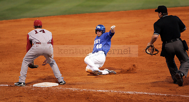Keenan Wiley slides to 3rd base in UK's game against Alabama staturday evening.