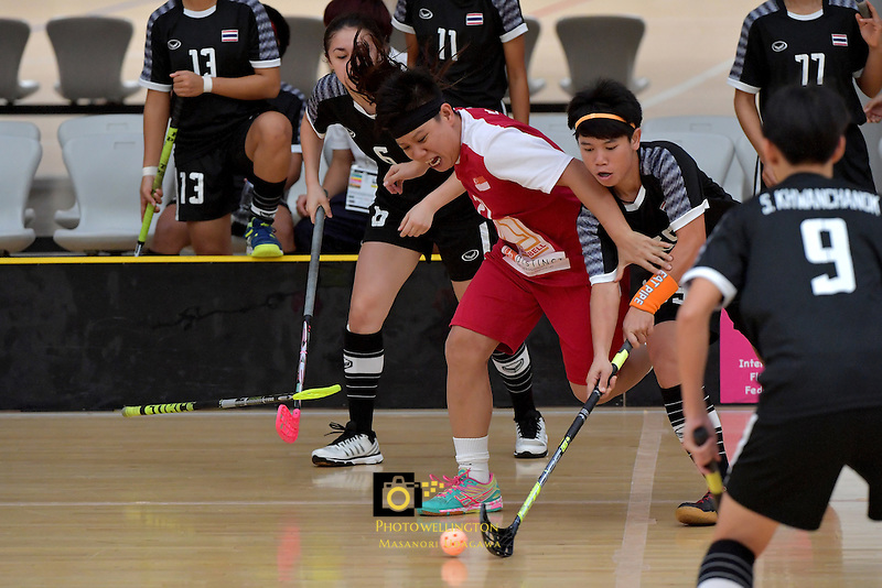 Singapore's Wilna Tan and Thailand's Thanaporn Tongkham in action during the World Floorball Championships 2017 Qualification for Asia Oceania Region - Singapore v Thailand at ASB Sports Centre , Wellington, New Zealand on Sunday 5 February 2017.<br /> Photo by Masanori Udagawa<br /> www.photowellington.photoshelter.com.