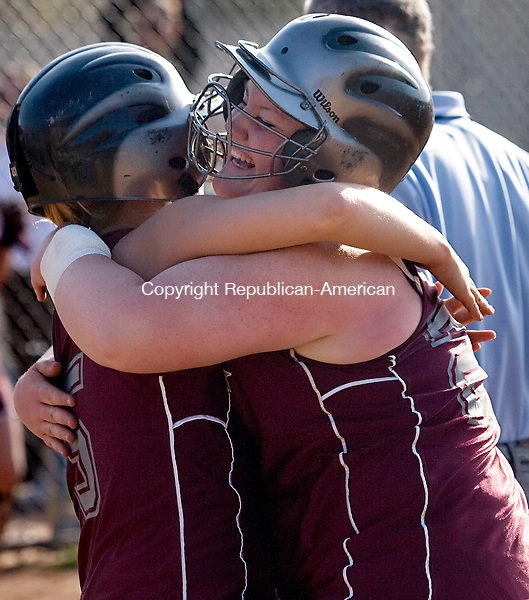NAUGATUCK--21 April 2008--042108TJ09 - Naugatuck's Jessica Russell, right, hugs teammate Alexis Granahan after Granahan scored the game-winning, tie-breaking run in the seventh inning during Naugatuck High School's 3-2 win against Woodland Regional High School on Monday, April 21, 2008. (T.J. Kirkpatrick/Republican-American)