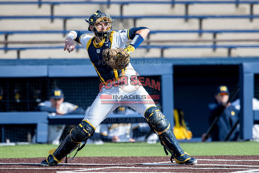 Michigan Wolverines catcher Harrison Slater (11) makes a throw to second base against the Western Michigan Broncos on March 18, 2019 in the NCAA baseball game at Ray Fisher Stadium in Ann Arbor, Michigan. Michigan defeated Western Michigan 12-5. (Andrew Woolley/Four Seam Images)