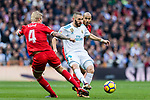 Karim Benzema (r) of Real Madrid fights for the ball with Simon Kjaer of Sevilla FC during the La Liga 2017-18 match between Real Madrid and Sevilla FC at Santiago Bernabeu Stadium on 09 December 2017 in Madrid, Spain. Photo by Diego Souto / Power Sport Images