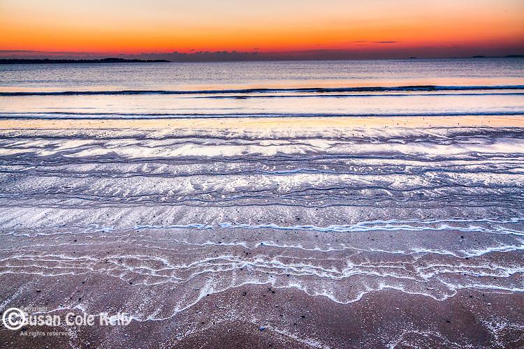 Sunrise on frozen sea foam at Revere Beach, Revere, Massachusetts, USA