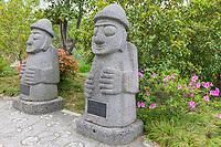 Yangzhou, Jiangsu, China.  Bonsai Garden, Slender West Lake Park.  Statues of the Patron Saint of Jeju Island, South Korea, Given by Spirited Garden, South Korea.