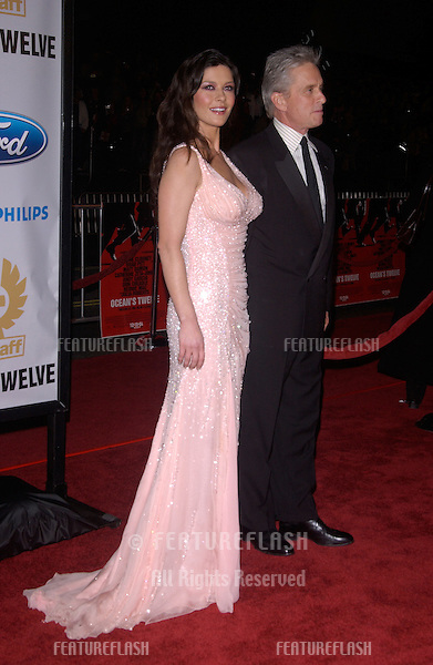 Dec 8, 2004; Los Angeles, CA: Actress CATHERINE ZETA-JONES & husband actor MICHAEL DOUGLAS at the Hollywood premiere of her new movie Ocean's Twelve..
