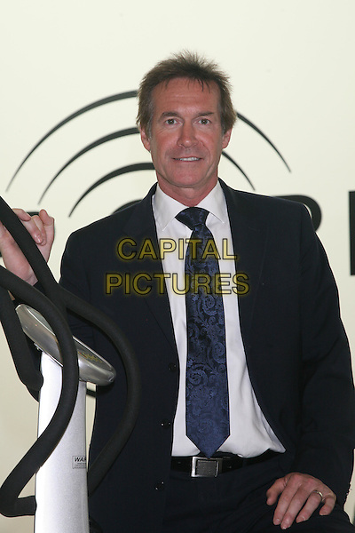 HILARY JONES .At the launch of The Power Plate home gym, London, England. .May 14th, 2008.half length blue tie black suit jacket .CAP/DS.©Dudley Smith/Capital Pictures