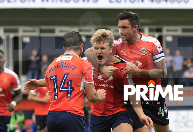 Cameron McGeehan of Luton Town (centre) celebrates his second goal during the Sky Bet League 2 match between Luton Town and Doncaster Rovers at Kenilworth Road, Luton, England on 24 September 2016. Photo by Liam Smith.