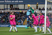 Goalkeeper Trevor Carson of Hartlepool United beats Adebayo Akinfenwa of Wycombe Wanderers to the ball  during the Sky Bet League 2 match between Wycombe Wanderers and Hartlepool United at Adams Park, High Wycombe, England on 26 November 2016. Photo by Andy Rowland.