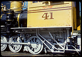 Fireman's-side view of cab and drivers of RGS C-19 #41 in gaudy Grande Gold paint job at Knott's Berry Farm lettered for Denver and Rio Grande.<br /> RGS (D&amp;RG)  Buena Park, CA  ca. 1970-1979