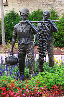 statue of men carrying giant grape bunch in village square marsannay cote de nuits burgundy france