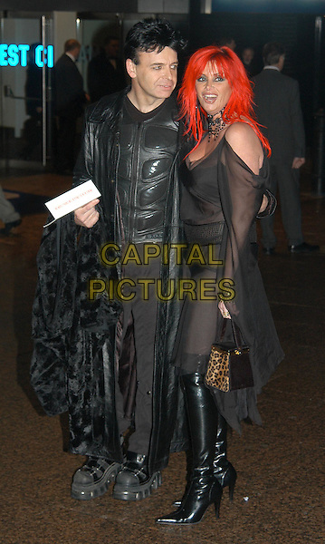 "GARY NUMAN & WIFE GEMMA.""The Lord of the Rings: The Return of the King"".UK Gala Film Premiere.Odeon cinema, Leicester Square, London.11 December 2003.leather, pvc, with date, red hair, leopard print purse, animal print, full length, full-length, see through, see thru.www.capitalpictures.com.sales@capitalpictures.com.©Capital Pictures"