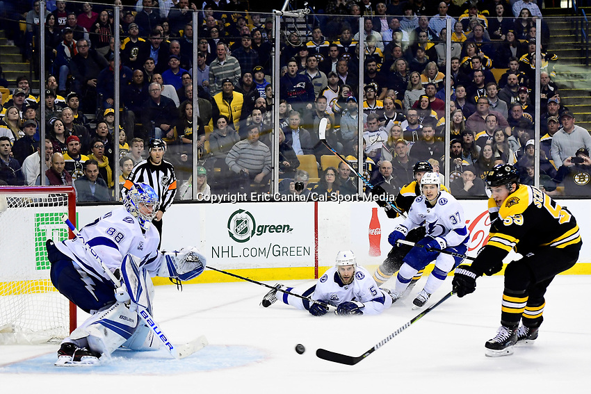 March 29, 2018: Boston Bruins center Tim Schaller (59) takes a shot at Tampa Bay Lightning goaltender Andrei Vasilevskiy (88) during the NHL game between the Tampa Bay Lightning and the Boston Bruins held at TD Garden, in Boston, Mass. Boston defeats Tampa Bay 4-2. Eric Canha/CSM