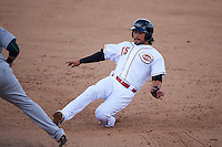 Peoria Javelinas second baseman Alex Blandino (15) slides safely into third during an Arizona Fall League game against the Mesa Solar Sox on October 21, 2015 at Peoria Stadium in Peoria, Arizona.  Peoria defeated Mesa 5-3.  (Mike Janes/Four Seam Images)
