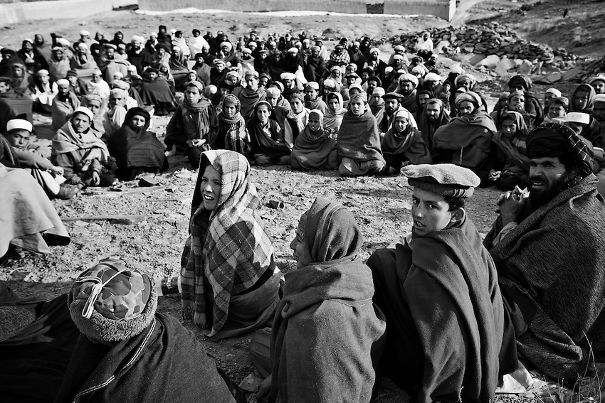 Afghan villagers gather to receive humanitarian aid in the village of Marzak, Paktika Province, Afghanistan, Thursday, Feb. 26, 2009.