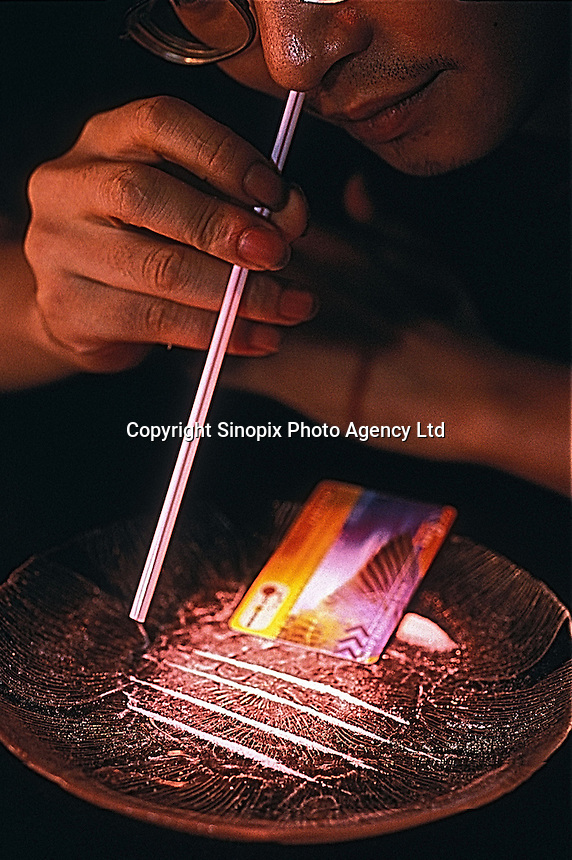 A drug addict taking ketamine, also known as, special-k and k-fen in Guangzhou, China. The drug is manufactureed in Burma and China and smuggled to hong kong and other destinations. ..PHOTO BY SINOPIX