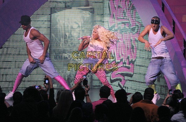 Nicki Minaj .live during The Pink Friday Tour (also known as the Roman Reloaded Tour) held at The Nokia Live in Los Angeles, California, USA..August 8th, 2012.on stage in concert gig performance performing music full singing length white t-shirt print boy black pink zebra animal print catsuit jumpsuit leotard jean denim cut fans crowd audience singing  half profile backup dancers                 .CAP/EAST.©Eastman/Capital Pictures.