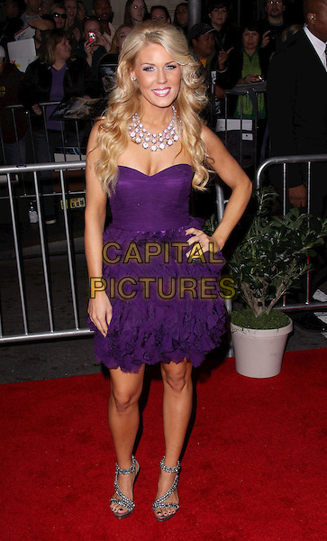 "GRETCHEN ROSSI.""The Tempest"" Los Angeles Premiere held at the El Capitan Theatre, Hollywood, California, USA..December 6th, 2010.full length purple strapless dress hand on hip ruffle frills silver sandals necklace .CAP/ADM/CH.©Charles Harris/AdMedia/Capital Pictures"